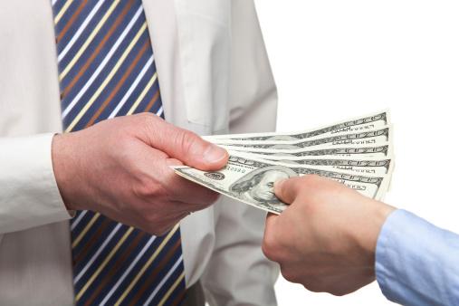 man paying cash