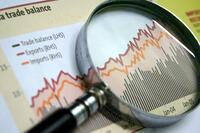 business chart magnifying glass