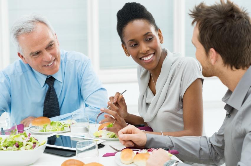 Three people eathing lunch