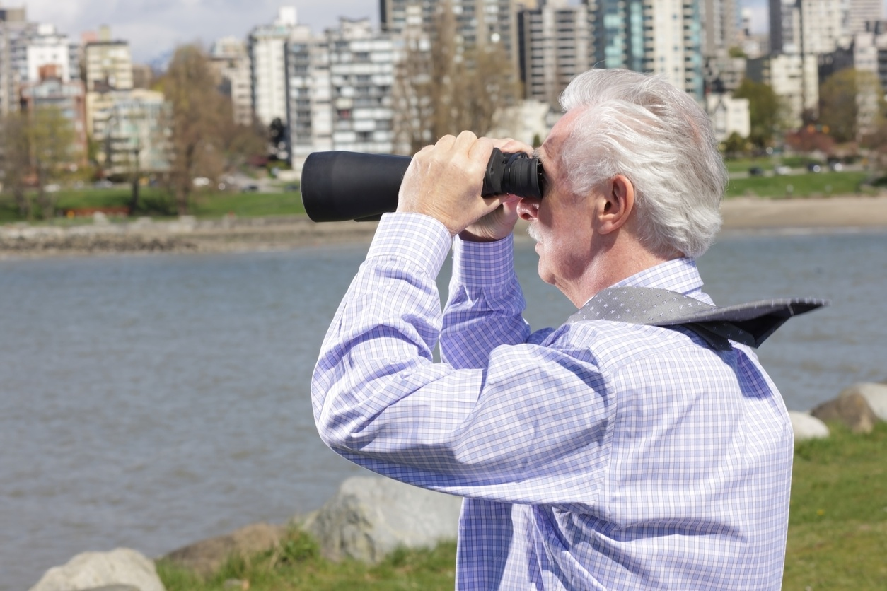 man with binoculars in the wind
