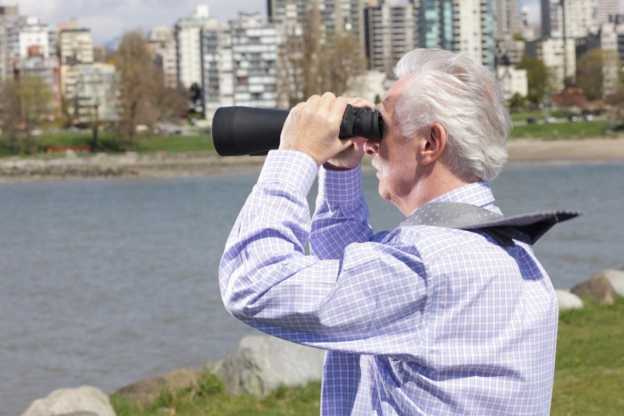 man with binoculars in the wind